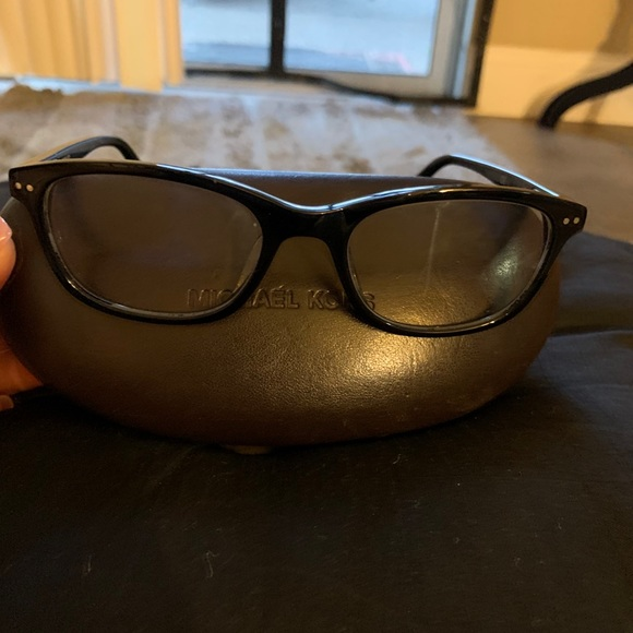 Michael Kors eyeglasses, cleansing cloth, and case